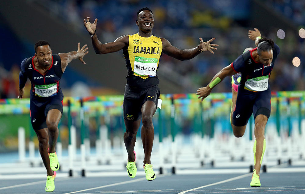 McLeod overcomes all obstacles including rain to win the men's 110 meter hurdles